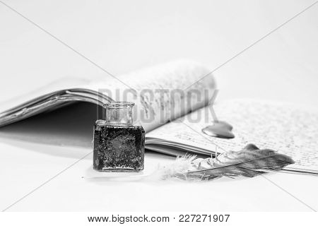 Old Writing Feather And Ink Spot With Handwritten Letter In Background, Black And White