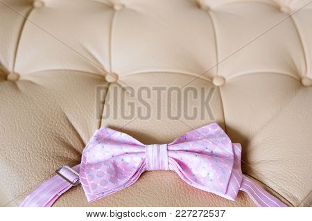 Pink Mens Tie For Wedding Suit On A Light Leather Background