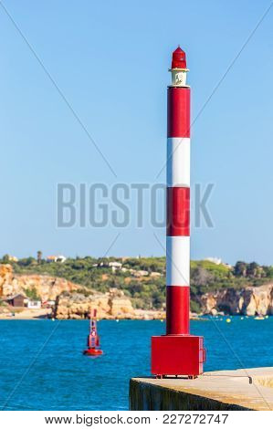 Beacon And Buoy With Blue Water At Portuguese Coast