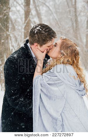 Couple On Nature In Winter During A Snowfall