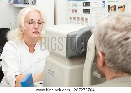 Saint Petersburg, Russia - February 13, 2018: The Ophthalmologist Examines The Vision Of A Mature Ma
