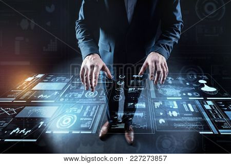 Transparent Screen. Calm Attentive Elegant Programmer Standing In His Laconic Convenient Office And
