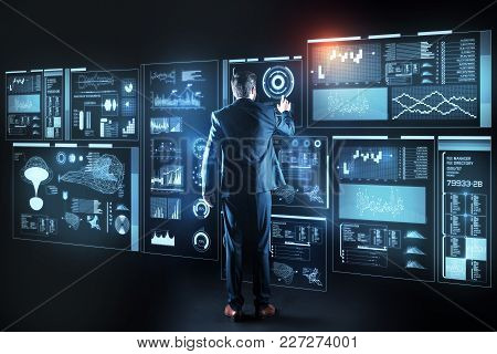 Experienced Specialist. Clever Qualified Professional It Manager Standing In Front Of A Futuristic G