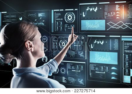Very Attentive. Smart Calm Experienced Programmer Standing In Front Of A Wonderful Futuristic Device