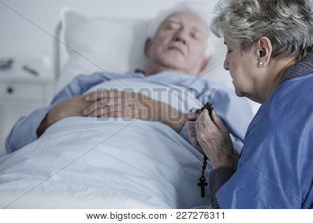 Woman Praying For Husband's Health