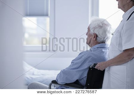 Caregiver Supporting Sick Patient