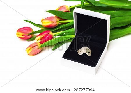 Car As Gift For Her, Concept. Miniature Car In Open Gift Box, Tulips