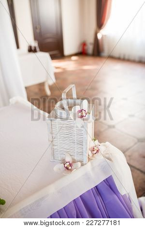 Decorative White Lantern With Bridal Flowers On The Newlyweds Table. Wedding Decoration
