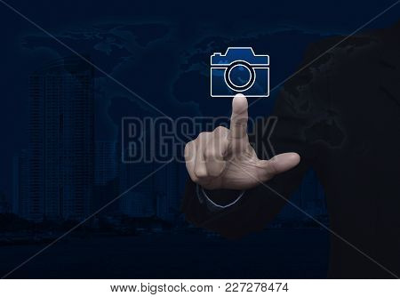 Businessman Pressing Camera Flat Icon Over World Map And Modern City Tower, Business Camera Service