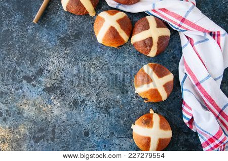Chocolate And Classic Hot Cross Buns On A Blue Stone Background. Copy Space. Top View.