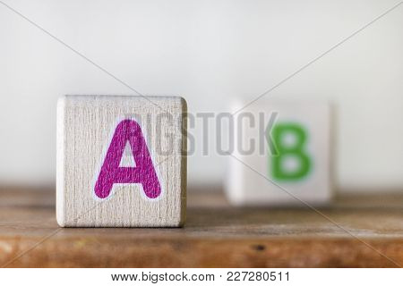 Wooden Cubes With Letters Illustrating The Sight Of Myopic People