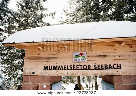 Mummelsee, Germany - Feb 18, 2018: Winter Day With Snow And Tower Gate Mummelseetor Seebach And Peop