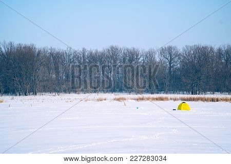Tent For Winter Fishing On A Frozen Lake. Winter Landscape