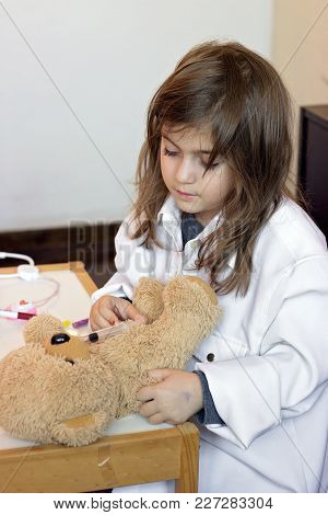Little Girl Pretends To Be A Doctor And Playing With Her Teddy Bear
