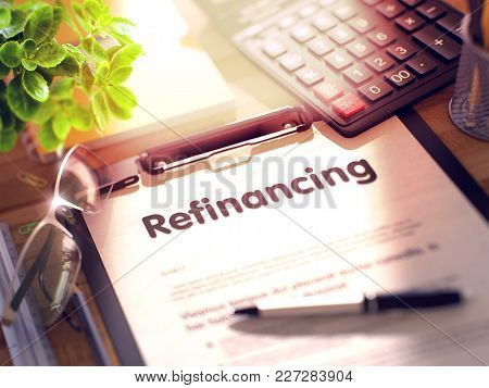 Refinancing- Text On Paper Sheet On Clipboard And Stationery On Office Desk. 3d Rendering. Toned And