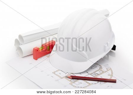Architectural blueprints, safety helmet, building level, pencil on a white background. Architect workplace. Engineering tools