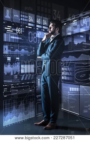 Careful Consideration. Calm Attentive Qualified Employer Of A Big Modern Company Standing In His Equ