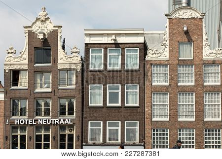 Amsterdam, Netherlands - April 20, 2017: Typical Gabled Houses On Damrak Street In Amsterdam, Hollan