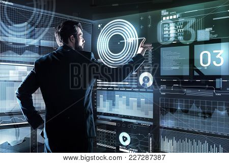 Worried Programmer. Serious Concentrated Smart Programmer Frowning While Looking At The Screen Of Hi
