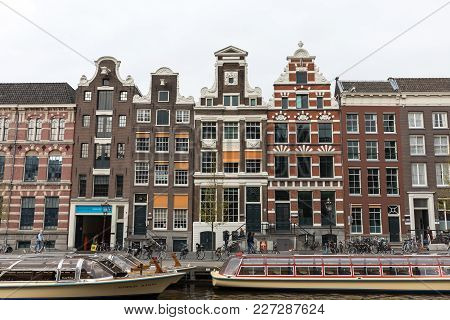Amsterdam, Netherlands - April 20, 2017: View On Rokin Canal, Oude Turfmarkt Street And Tourboats Re