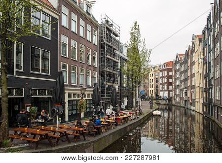 Amsterdam, Netherlands - April 20, 2017: Canal Houses In The Red Light District, Amsterdam, Netherla