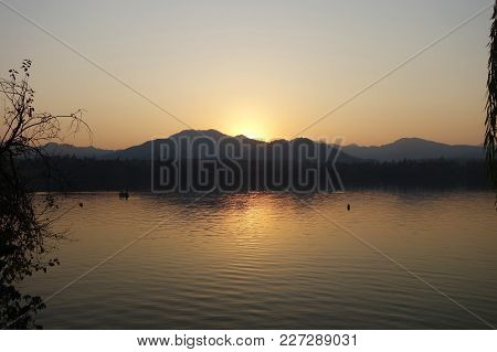 Sunset At West Lake (xihu) In Hangzhou China. West Lake Is The Main Attractions In Hangzhou.
