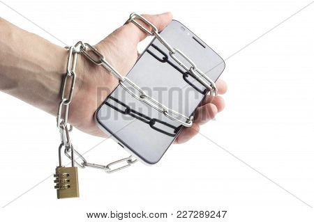 Iron Chain That Ties Together Hand And Smart Phone In Concept Of Social Media And Internet Addiction