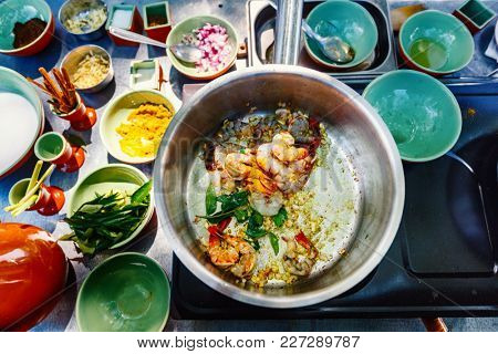 Preparation of traditional Sri Lankan curry dish with shrimps at cooking class