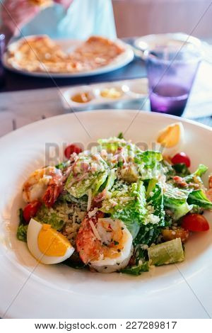Delicious Caesar salad with grilled shrimps served for lunch or dinner