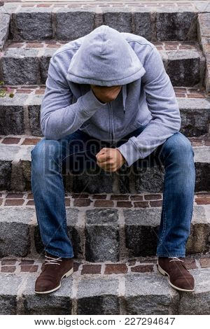 man is sitting on steps