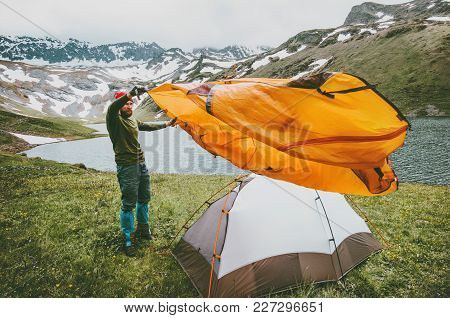 Man Adventurer Pitching Tent Camping Gear Outdoor Travel Survival Lifestyle Concept Summer Trip Vaca