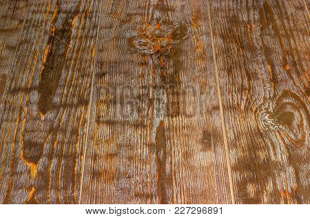 Background Of Surface Of The Old Dark Wooden Rustic Table, Darkened With Time