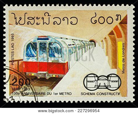 Moscow, Russia - February 18, 2018: A Stamp Printed In Laos, Shows Metro Station And Train In London