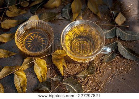Neem Tea With Leaves On A Wooden Surface Is Immune Boosting - Neem Leaf Tea Is A Good Immune Boostin