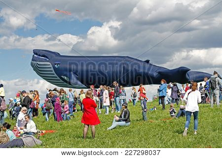 Moscow, Russia - May 27, 2017: People Stand Against The Background Of A Huge Whale Kite At The Kite