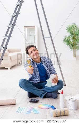 Young man overspending his budget in refurbishment project