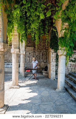 Balchik, Bulgaria, June 25, 2017: a man playing xylophone in Balchik Palace gardens in Balchik, Bulgaria