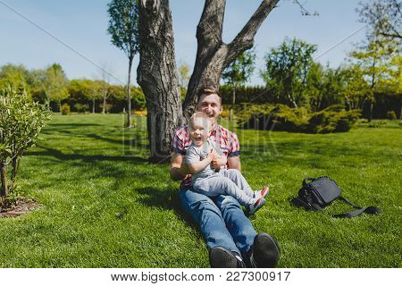Joyful Man Walk On Green Park, Rest, Have Fun, Play, High Toss Up Little Cute Child Baby Boy Sit On