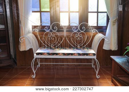 White Iron Bench In The Warm Room With Sunlight
