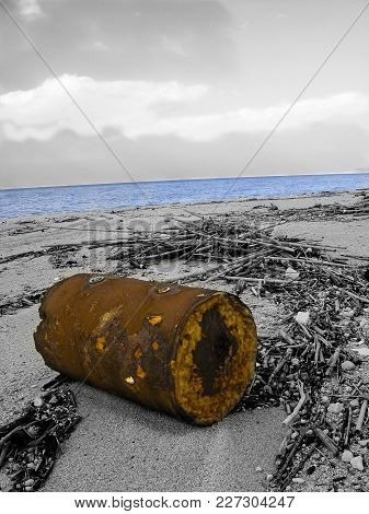 Beach In Calabria Polluted From Litter In A Monochome Photo With A Few Parts At Color