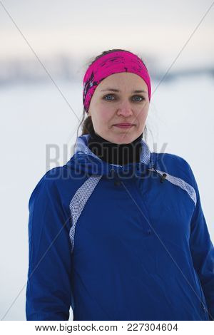 Portrait Of A Young Female Sportswoman In Winter Ice River, Sport And Leisure Concept