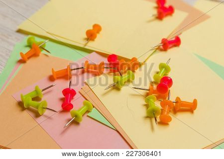 Stationary, Coloured Pushpins Lying On Blank Stickers Note Paper. Strategy Planning Concept