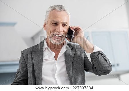 White Teeth. Attractive Businessman Feeling Happiness While Talking Per Telephone And Looking Forwar