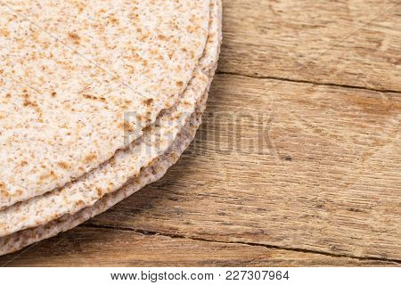 Tortilla  On Wooden Table Background