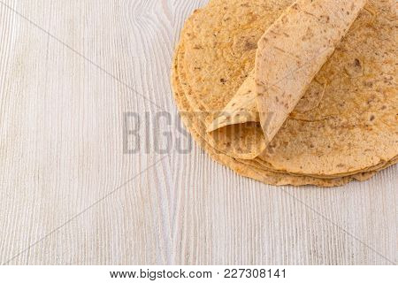 Tortilla  On Wooden Table