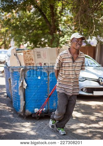Johannesburg, Gauteng, South Africa, 2018/01/10.  A Waste Picker In South Africa, Pulling His Waste