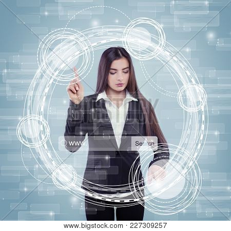 Young Woman Touching Sensitive Screen While Selecting Surface Option. Female Standing At Big Virtual