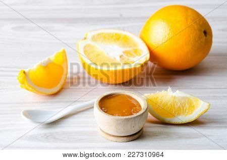 Orange jam served in spoon on the table