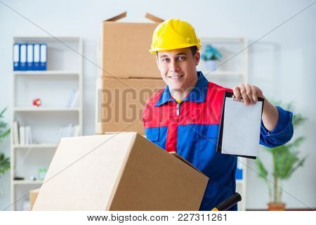 Young man working in relocation services with boxes