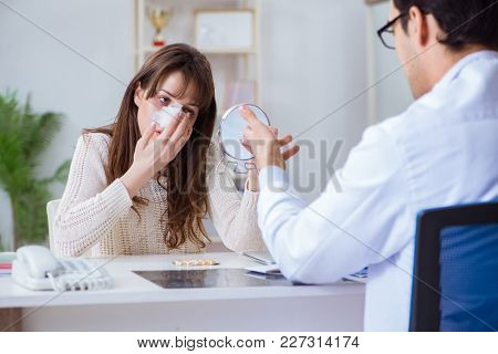 Male doctor talking to patient with nose operation surgery